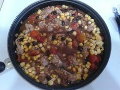 green chile sausage with beans tomatoes and corn