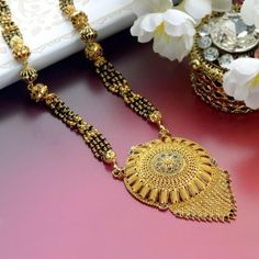 Explore the trendy collection of Gold Mangalsutra design at Waman Hari Pethe Sons. Rose Gold Jewelry, Wedding Jewelry, Gold Jewellery, Beaded Jewelry, Jewellery Designs, Jewelry Patterns, Jewelry Art, Diamond Jewelry, Jewelry Rings