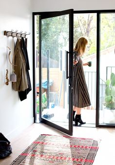 love the pivot on the door instead of hinges  Home Tour: A Modern Family's Custom Hillside Home via @domainehome