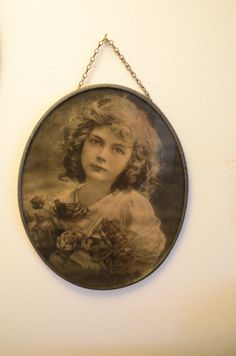 Vintage 1920's Photo Girl With Roses in Oval Tin Frame by fancypak on Etsy https://www.etsy.com/listing/257549334/vintage-1920s-photo-girl-with-roses-in