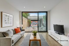 Polished concrete floors in the lounge room, Brunswick East home. Real Estate Photography, Polished Concrete, Concrete Floors, Living Rooms, Oversized Mirror, Gallery Wall, Lounge, Flooring, Creative