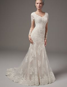 MELROSE LYNETTE Sottero and Midgley MELROSE LYNETTE Beautiful lace appliqués done in the most beautiful style. This chic fit-and-flare wedding dress, featuring a lace illusion train, sweetheart neckline, illusion long-sleeves, and back ruching is one of my favorite wedding dress inspirations!!   #StarstruckRomance
