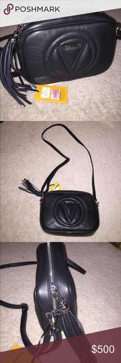 """NWT VALENTINO MIA CROSS BODY BAG Valentino Mia crossbody bag in black. New with tags. Great for all year round. Great size to hold everything and very light weight. The hardware of this bag is silver.  Made out of Italian leather complemented by a luxe leather tassel and quilted insignia.  Top zip closure. Made in Italy.  Includes dust cover.  9""""W X 6.5""""H X 3""""D Valentino Bags Crossbody Bags"""