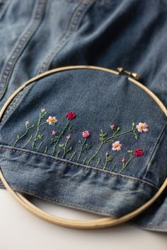 Make a fabulous DIY embellished jean jacket, . Make a fabulous DIY embellished jean jacket, Always aspired to figure out how to k. Embroidery On Clothes, Embroidered Clothes, Vintage Embroidery, Diy Embroidery, Hand Embroidery Patterns, Embroidery Designs, Embroidery Stitches, Embroidery Digitizing, Diy Embroidered Jean Jacket