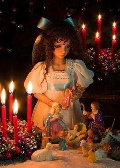 Lifelike doll with Nativity scene