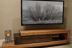 This walnut TV stand was created for a client along with nine other furniture pieces.