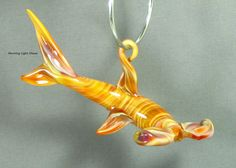 Glass shark ornament handmade using borosilicate glass. This fun colored lampwork sculpture is a one of a kind. When the light hits it the colors sparkle and shine. Great gift for any shark lover in your life!   Sale Original Price $40 ... Now $25  *** Clearance Sale.. after 20 years Im discontinuing my Sealife Collection to move onto new passions**  ● 4L x 2 W ● Comes with Artist Bio ● Note Card  More Sharks : http://etsy.me/2b677GV ____________________________________________...