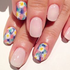 A blush manicure with watercolor pastel floral nail art.