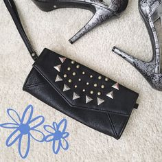 HOST PICK  || NWOT Sexy Black Studded Wristlet ✨ ★ NWOT, never been used.  ★ Features a cute studded pattern and wrist strap. Can also perfectly fit an iPhone 6s Plus! ★ NO TRADES!  ★ YES OFFERS! ✅ ★ Measurements available by request.  ★ Selected as HOST PICK for the Casual Cool party on 4/20/16! Thank you so much @jaymoon!  Bags Clutches & Wristlets
