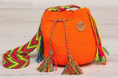 This Gorgeous & cute Wayuu mini Mochila Bag ismade by the women of the Epieyu communities in Colombia and has taken one and half weeks to make.