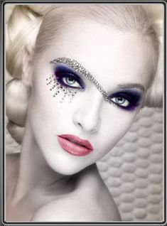 Fairy makeup - purple eyeshadow, lots of black eyeliner, pinky-red lips, pale white face and hair; diamond- glitter eye decoration.