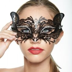 """Black """"Feline"""" Inspired Mardi Gras Masquerade Mask -Made with eco-friendly metal material. -Laser Cut -Beautiful Rhinestones design.  -One size fits most. -Perfect for masquerade balls, weddings, proms, parties, dances, music festivals, raves, Mardi Gras, etc. Jewelry"""