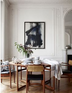 Minimal new midcentury modern white neutral monochrome palette dining room French Parisian apartment