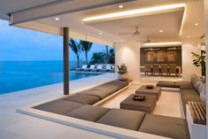 A semi-outdoor entertaining area like this would be the ultimate for me!  Doesn't it look relaxing, and welcoming?  Your guests would never want to leave! Who could blame them?