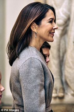 Oct 2016--Just like mum: Looking increasingly like her mother, Princess Isabella was all smiles as she arrived in a blush pink jacket and navy floral print dress