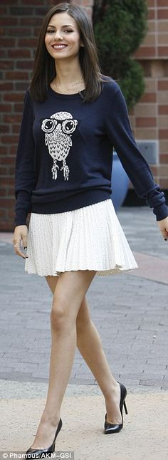 Stylish star: The Eye Candy starstyled her top with a white skirt speckled with black dot...