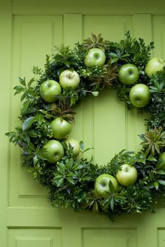 Leave it to me to do a post on wreaths featuring food...     apples       brussel sprouts           radishes      gumdrops       hmmm not ...