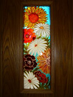 I love how this dramatic design has been fitted into a new bespoke oak door. Louise asked me to do a design based on the flowers growing all around her home. The colours give a fresh feel and reflect coloured light into the hall way. For a unique design just for you get in touch at debsinledbury@live.co.uk or go to my web site www.thegassorchard.com