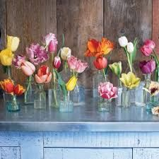 bud vases with bright flowers  - cost effective option for centrepieces