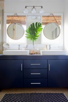 And Jordan completely overhauled the bathroom with a brand new navy vanity and matching porthole mirrors.
