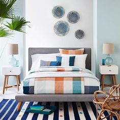 West Elm Mod Upholstered Bed. Nice piping details. $1000 for a king including in-home delivery.