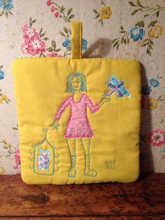 Paper doll potholder