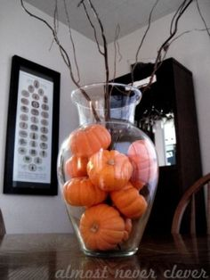 Simple Fall Decor. I think spray paint on a few of those pumpkins would be even better!