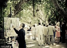 Live painting during a wedding ceremony on Banyan Street.