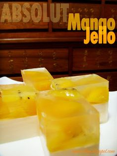 Mango Jello Shots...The ingredients are pretty much simple: Absolut Mango, Agar-agar powder (I always like to use the Mermaid brand from Thailand), Pandan leaves (from my garden), F evaporated milk, caster sugar, mango cubes and Golden Kiwi.