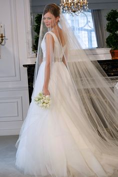 Again, I'm not a veil girl, but I love long, gauzy, ethereal ones like this. maybe!