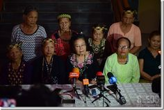 ebong (seated centre) with weavers from Uma Nyaving speaking to the press.