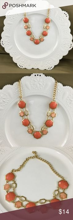 Statement Goldtone Necklace with Coral beads NWOT Statement Necklace -- NEW WITHOUT TAG! Goldtone chain with Coral colored beads in two shades PERFECT for Summer!  Lightweight and not heavy Lays flat at neckline Adjust length of chain to your liking   NOTE -- I price my items higher to allow for offers and discounts!  AP-19 Fashion Jewelry Jewelry Necklaces