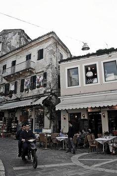 Busy street cafe in Corfu, Greece