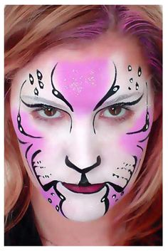 Paints face like cat. Has lots of cats