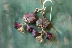 Hey, I found this really awesome Etsy listing at http://www.etsy.com/listing/150276562/lovely-lavender-czech-glass-leaf-flower