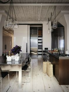 white wood flooring with dark wood cabinets