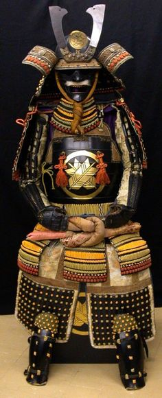 Full suit of Japanese Samurai armour (Gusoku), 16th to 18th century; Edo period Japanese Lacquered iron, mail, silk, copper-gilt.