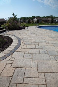 Stone pavers are a durable material that could be created into quite a few shapes and patterns. Rubber Synthetic pavers have gotten popular recently since they are environmentally friendly as they're made from recycled tires. Large Backyard Landscaping, Backyard Pool Designs, Patio Design, Backyard Patio, Landscaping Ideas, Pool Paving, Patio Makeover, Exterior, Patio Ideas