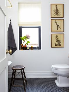 powder room - i like how they painted the walls white but the window trim dark to match the floor