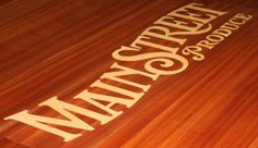 Custom solid wood inlaid logo branding a corporate conference room table, by Specialty Woods (509) 466-4684