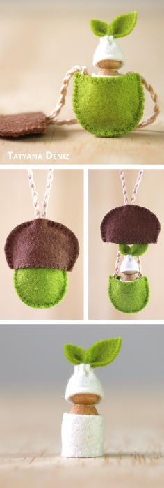 Waldorf / Steiner baby doll necklace of an acorn sprouting a seed. Felt, cotton yarn, wood.