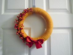 Would be uber cute for a wintery-ish wreath...with white or lighter blue instead of that ugly orange