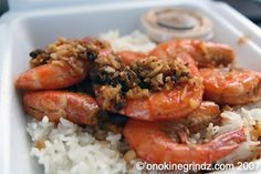 Romy's Kahuku Prawns & Shrimp, Inc. Fragrant chunks of garlic were spooned carefully atop a pile of shrimp (about 10 shrimp). The shrimp were served with both the head and shell still intact, keeping them sweet and succulent.