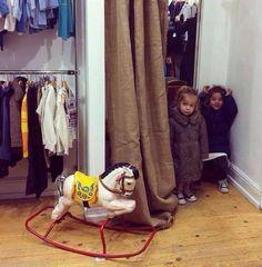 Peek-a-boo... Two gorgeous little girls enjoying the new FARA Kids shop in Fulham