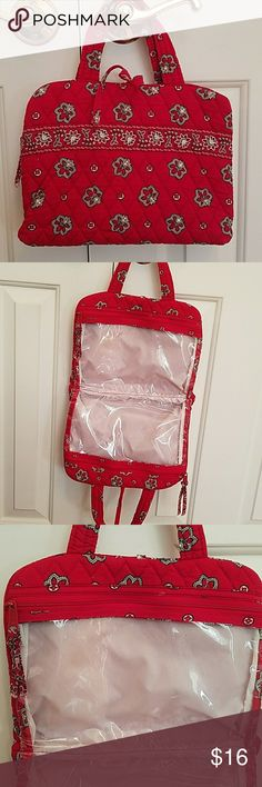 Vera Bradley hanging cosmetic case Retired red bandana pattern. Great condition,  no stains or rips.  No longer suits my traveling style. Each side has a zipper. Holds a lot. Folds and ties for packing.  Hangs on hook or door knob. Vera Bradley Bags Cosmetic Bags & Cases
