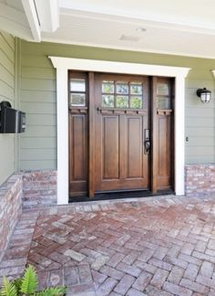 Love the front door! Would be perfect on a Craftsman style home. Love this front door/brick porch area: a similar exterior stain is Yankee Barn 3505 by Sherwin Williams - Studio S Squared Architecture, Inc. I love the brick the door and the color! House, Craftsman Front Doors, Craftsman Bungalows, House Exterior, Exterior Design, New Homes, Front Door, Craftsman House, House Colors