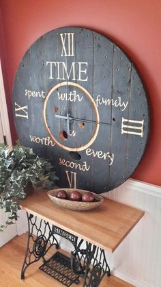 """Wood spool clock & treadle table- mine would say, """"Time spent making memories is worth every second. Big Clocks, Cool Clocks, Farmhouse Clocks, Farmhouse Decor, Wooden Clock, Wooden Diy, Pallet Clock, Spool Tables, Spool Crafts"""