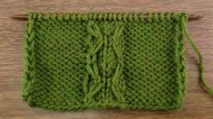 Example of the Slipped Double Chain Cable Stitch on a Reverse Stockinette Background