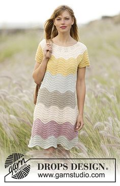 "Knitted DROPS dress with stripes and wave pattern, worked top down in ""Belle"". Size: S - XXXL."