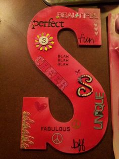 This is a great and cheap birthday present for your girlfriends! I just get their first initial, paint it their favorite color and get stickers and decorate it using words that describe her